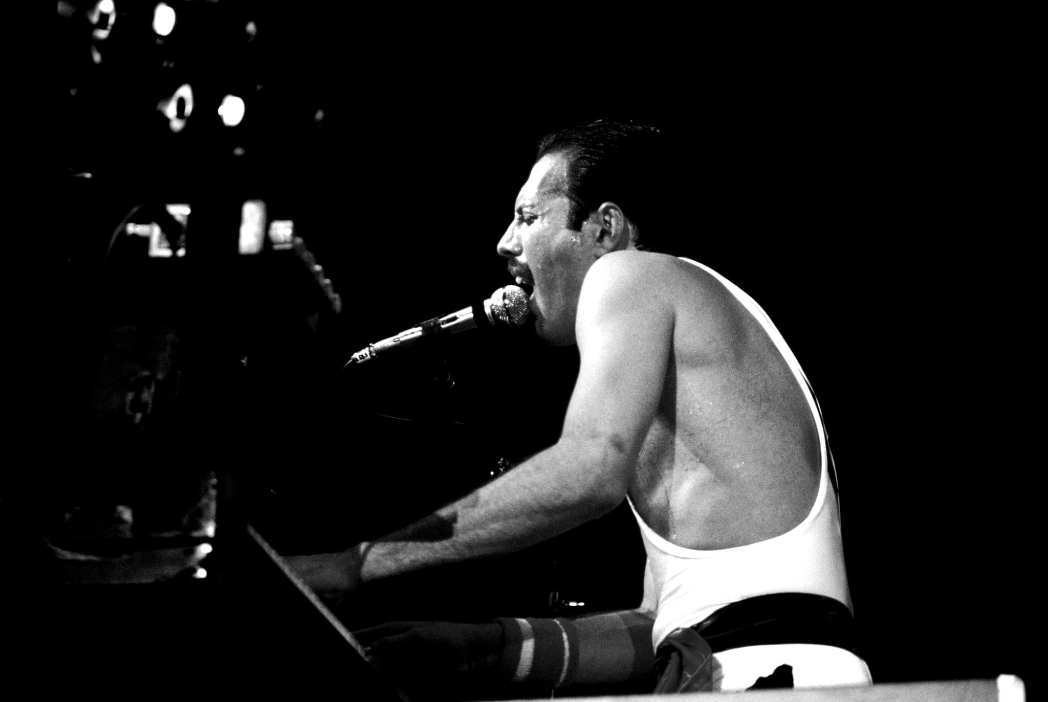 Freddie Mercury, singer of the band Queen, performs at Wembley Arena in London on 7th September 1984.